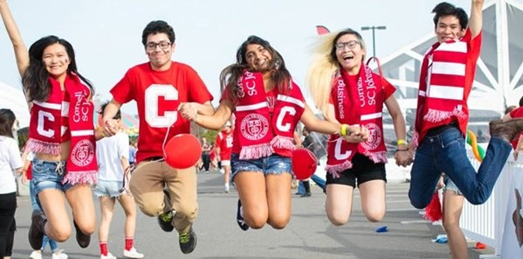 Cornell Students Holding Hands and Jumping With Excitement